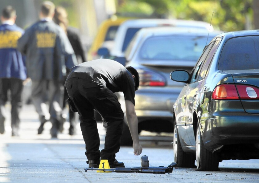 At a shooting scene in South L.A. in August