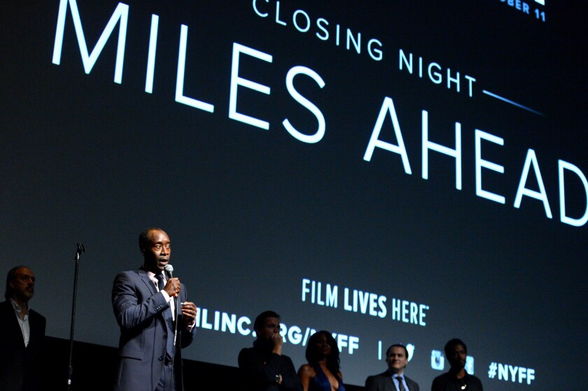 """Filmmaker Don Cheadle, left, speaks on stage at the closing night gala screening of """"Miles Ahead."""""""