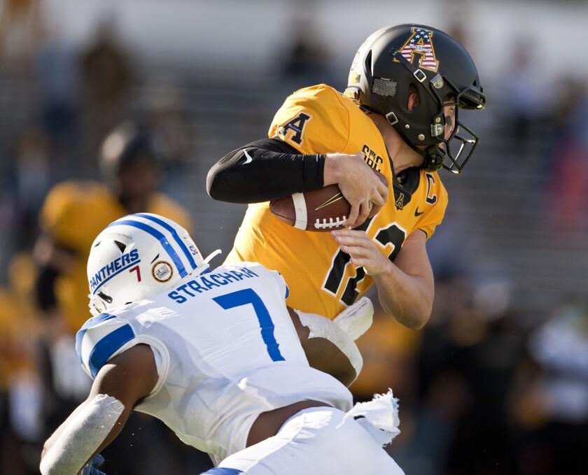 Appalachian State quarterback Zac Thomas is sacked by Georgia State's Jordan Strachan in the first half of an NCAA football game, Saturday, Nov. 14, 2020, in Boone, N.C. (Walt Unks/Winston-Salem Journal via AP)