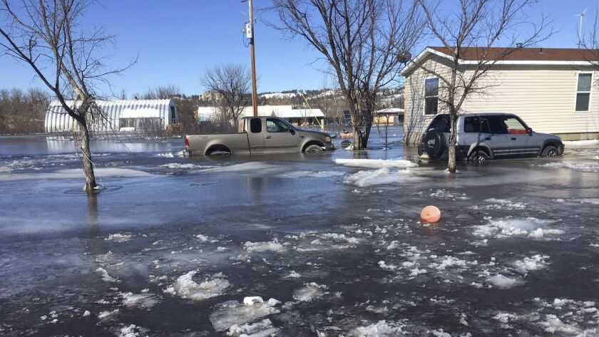 This March 2019 photo provided by Henry Red Cloud, shows flooding on Cloud's Lakota Solar Enterprise