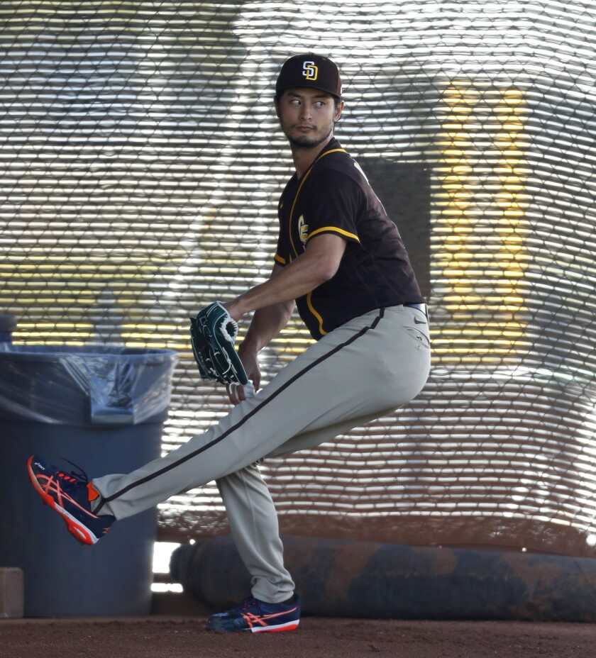 Padres pitcher Yu Darvish works out at the Padres facility in Peoria, Ariz.