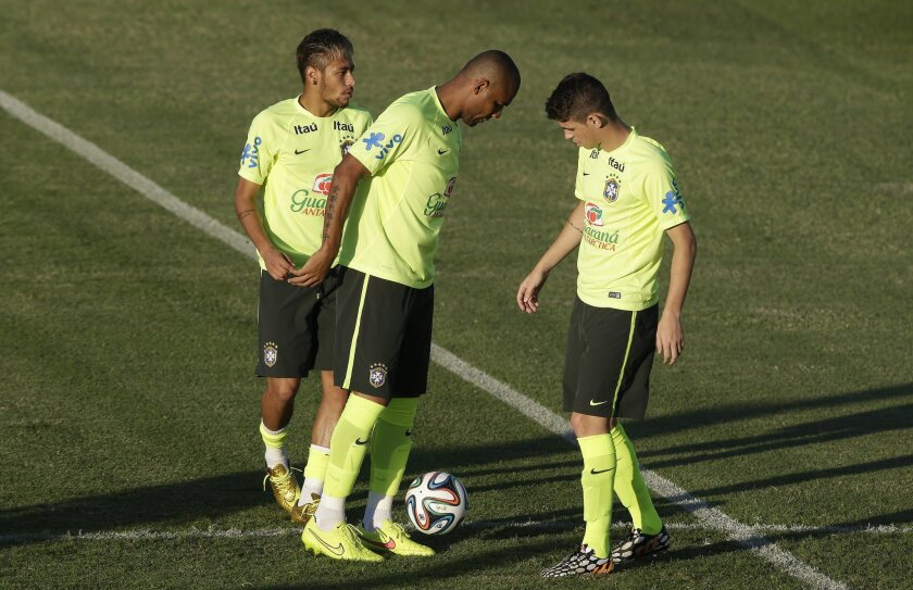 Brazil's Maicon, center, Neymar, left, and Oscar attend a training session the day before the quaterfinal World Cup soccer match between Brazil and Colombia in Fortaleza, Brazil, Thursday, July 3, 2014.(AP Photo/Andre Penner)