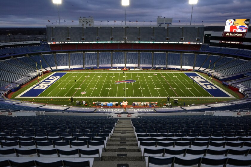 FILE - In this Dec. 13, 2020, file photo, the stadium is mostly empty before an NFL football game between the Buffalo Bills and the Pittsburgh Steelers in Orchard Park, N.Y. A person with direct knowledge of discussions tells The Associated Press the cost of the Bills proposed new stadium is $1.4 billion; the stadium is to be built across the street from the team's existing facility. The person spoke to The AP Thursday, Aug. 12, on the condition of anonymity because the details of proposal haven't been made public. (AP Photo/Gene J. Puskar, File)