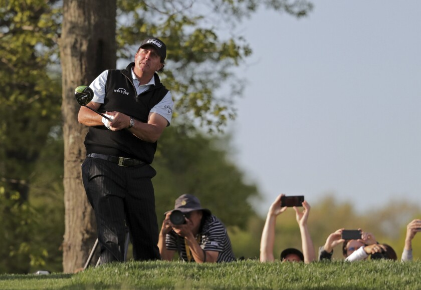 Phil Mickelson watches his shot off the 18th tee during the first round of the PGA Championship golf tournament Thursday at Bethpage Black in Farmingdale, N.Y.