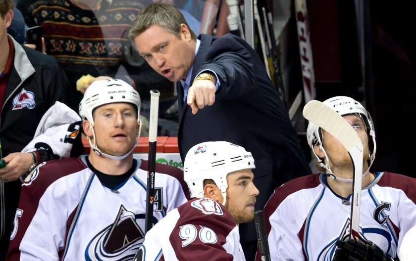 Colorado Avalanche head coach Patrick Roy, center, speaks to Cody McLeod, left, as Ryan O'Reilly, bottom, and Gabriel Landeskog, right, of Sweden, look on during second period NHL hockey action against the Vancouver Canucks in Vancouver, British Columbia, on Sunday Dec. 8, 2013. (AP Photo/The Canadian Press, Darryl Dyck)