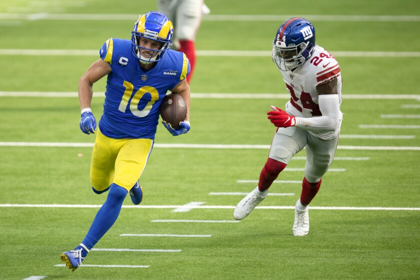 Rams wide receiver Cooper Kupp sprints for a touchdown past New York Giants cornerback James Bradberry