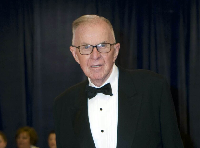 "John McLaughlin, host of ""The McLaughlin Group,"" arrives at the White House Correspondents' Association dinner in Washington in 2012."