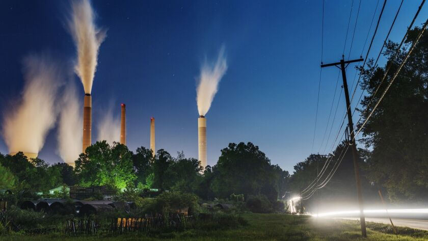 The John E. Amos Power Plant is seen from a field outside of Winfield, W. Va., on Thursday night, Au