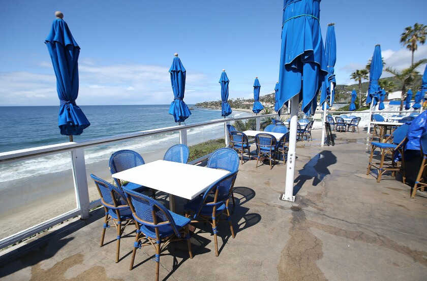 The Cliff, an outdoor restaurant and music venue in Laguna Beach, is empty of patrons on the view deck as restaurants around the region comply with orders to stop dine-in service during the coronavirus outbreak.