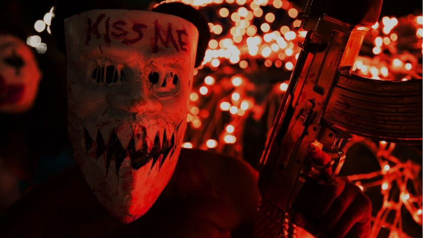 """A Purger in the movie """"The Purge: Election Year."""""""