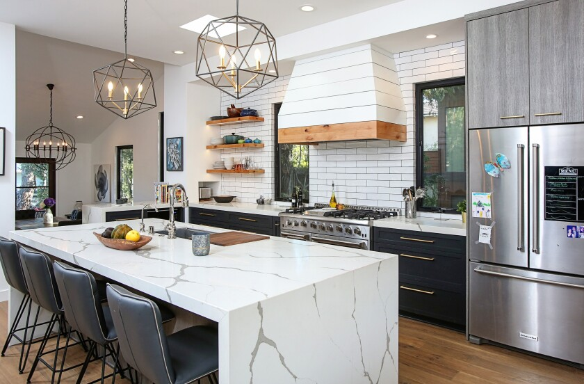 Alison Pilette loves the way the Marrokal Design & Remodeling team opened the kitchen. She also loves that they lined the kitchen drawers with wood, not melamine.