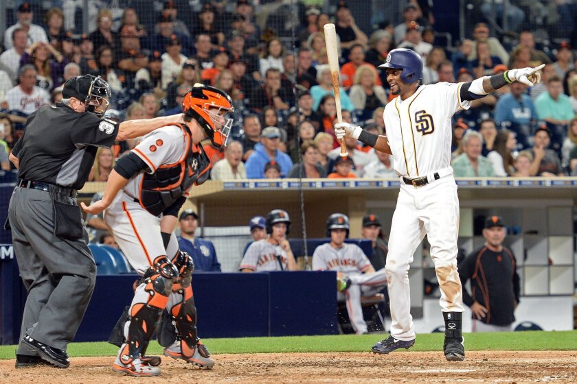 Jul 16, 2016; San Diego, CA, USA; San Diego Padres shortstop Alexei Ramirez (right) signals for a balk from homeplate umpire Dana DeMuth (32) during the tenth inning as San Francisco Giants catcher Buster Posey (center) looks on at Petco Park. The San Diego Padres win 7-6. Mandatory Credit: Jake Ro