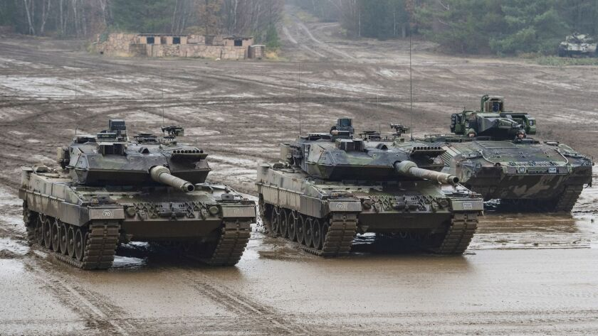 File--- Picture taken Dec.6, 2018 shows two Bundeswehr main battle tanks (from left), type Leopard 2
