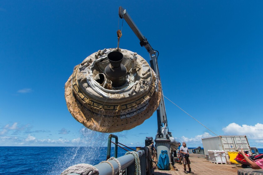 Crews fish the LDSD from the Pacific after Saturday's test. Even though the parachute did not fully inflate, the vehicle looks to have survived intact.