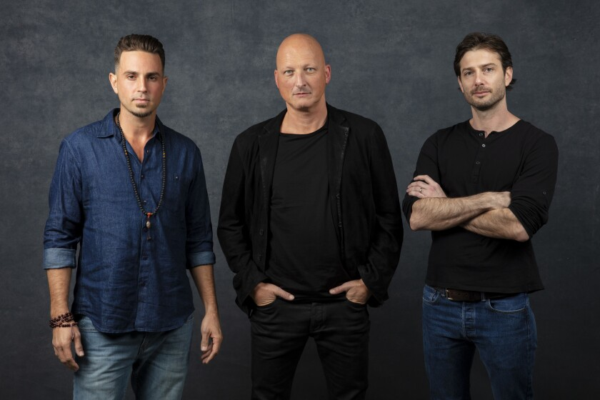 """Wade Robson, left, """"Leaving Neverland"""" director Dan Reed and James Safechuck at the Sundance Film Festival this year."""