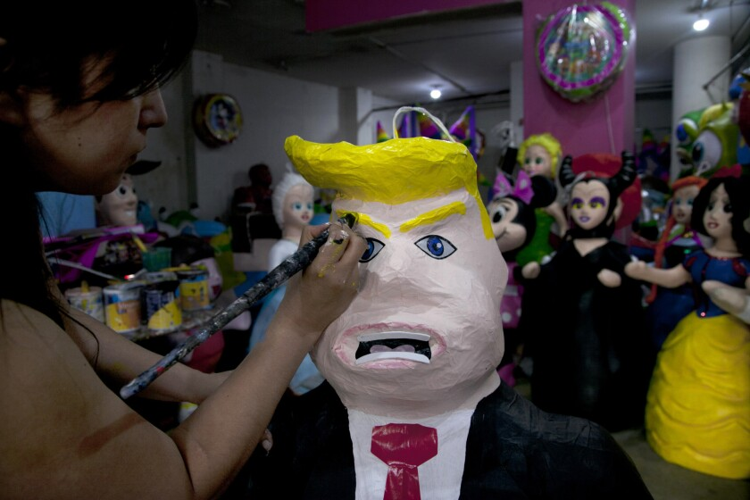 Piñata makers in Mexico have discovered that many customers are eager to take a whack at Donald Trump. Alicia Lopez Fernandez puts finishing touches on a Trump piñata at her family's shop in Mexico City.