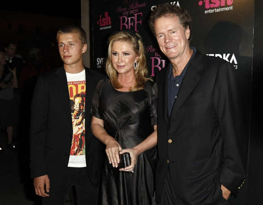 """FILE - In this Sept. 30, 2008 file photo, Conrad Hilton, left, Kathy Hilton, center, and Rick Hilton arrive at the launch party of new MTV series """"Paris Hilton's My New BFF"""" in Los Angeles. Paris Hilton's youngest brother, Conrad, has been sentenced to community service and a $5,000 fine for disrup"""