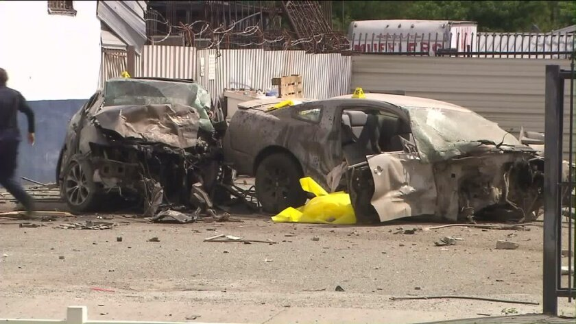 Two people were killed when a driver allegedly ran a red light and crashed into another car in San Bernardino.