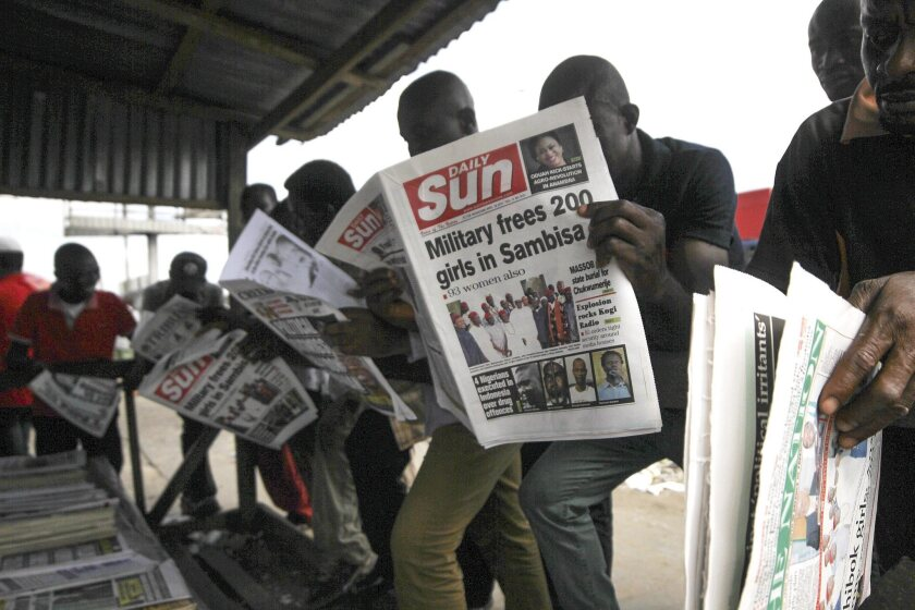 Nigerians in Port Harcourt read at a newsstand April 29 about the release of 293 kidnap victims from Boko Haram militant camps by the Nigerian military.