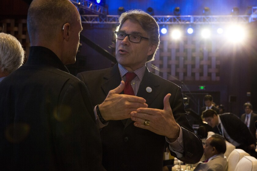 In this photo taken Wednesday, June 7, 2017, U.S. Energy Secretary Rick Perry attends the opening ceremony of an international clean energy conference held in Beijing, China. Energy ministers from around the world gathered in Beijing this week to report increased spending to help counter climate change. Yet one prominent voice, that of U.S. Energy Secretary Rick Perry, delivered a starkly countervailing message as the Trump administration seeks to roll back spending on clean energy and promote fossil fuels.