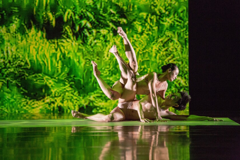 """Cloud Gate Dance Theatre's Huang Pei-hua, top, and Tsai Ming-yuan are among the performers in """"Rice"""" who embody soil, wind, water and other elements."""