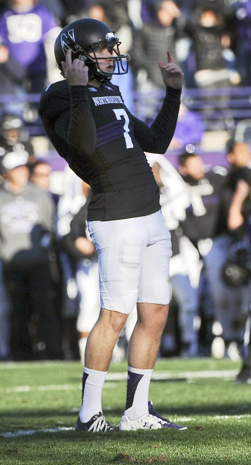 Northwestern place kicker Jack Mithchell (7) reacts after kicking the game-winning field goal in the closing second of the second half of an NCAA college football game against Penn State in Evanston, Ill.,  Saturday, Nov. 7, 2015.  Northwestern beat Penn State 23-21. (AP Photo/Matt Marton)
