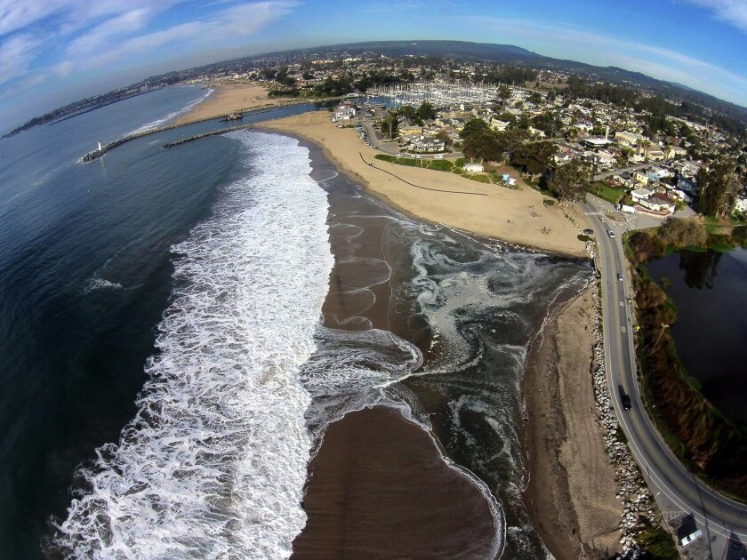 A photo taken by drone of Twin Lakes Beach in Santa Cruz and Schwann Lagoon, far right, is part of a project to map flooding and coastal damage after El Niño storms with the aim of envisioning the effect of rising sea levels.