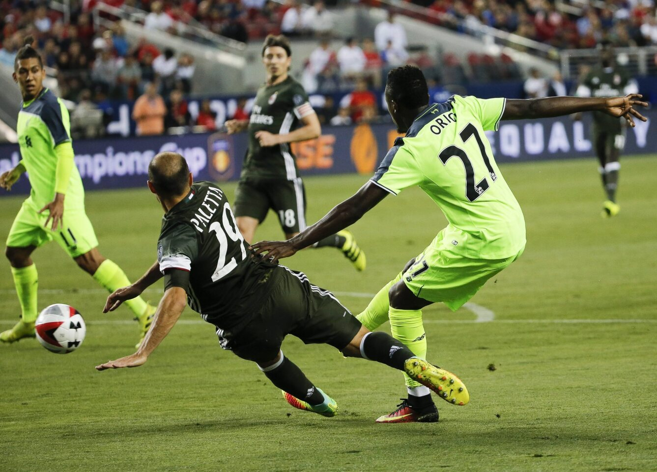 Liverpool FC's forward Divock Origi (R) scores a goal past AC Milan's Gabriel Paletta (C) during the second half of the International Champions Cup at Levi's Stadium in Santa Clara, California, USA, 30 July 2016. Liverpool FC defeated AC Milan.
