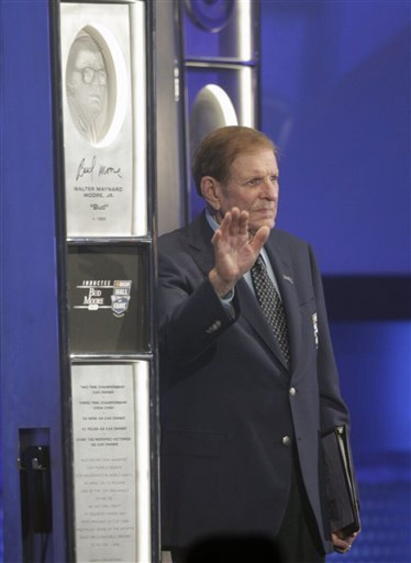 Bud Moore stands beside his induction spire after being inducted into the NASCAR Hall of Fame during a ceremony in Charlotte, N.C., Monday, May 23, 2011. (AP Photo/Chuck Burton)
