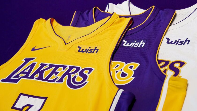 brand new 033b1 5b922 Lakers to get more than $30 million from three-year jersey ...