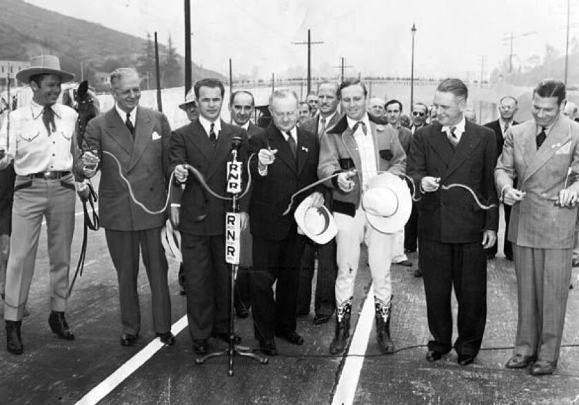 Politicians have been talking about Southern California's traffic for decades, but for as many ribbons as they have cut on new projects, gaining ground on the problem has proved difficult. In1940, the Cahuenga Pass Freeway was dedicated. From left are Tom Keene, honorary mayor of Sherman Oaks; Gov. Culbert Olson; John B. Kingsley, president of the Hollywood Chamber of Commerce; Los Angeles Mayor Fletcher Bowron; Gene Autry, honorary mayor of North Hollywood; Burbank Mayor Frank C. Tillson; and Richard Arien, honorary mayor of Sunland.