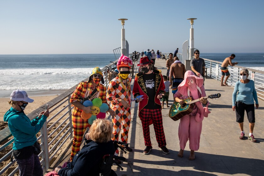 Singers perform for   passersby on the Hermosa Beach Pier.