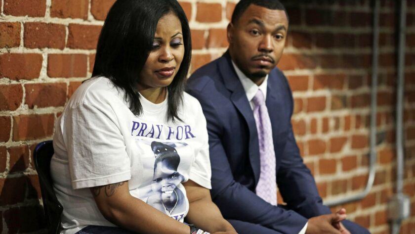 FILE - In this Oct. 3, 2014, file photo, Nailah Winkfield, left, and Omari Sealey, right, the mother