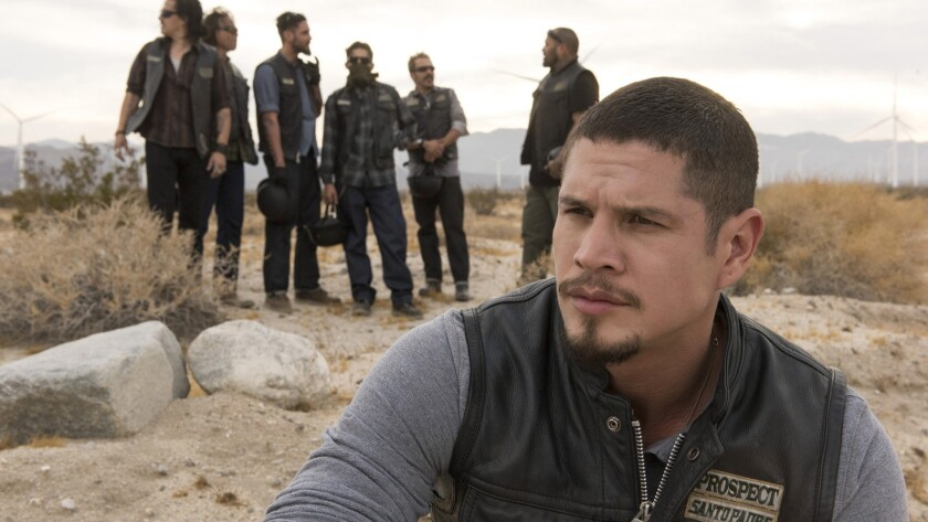 This image released by FX shows James Olmos as Felipe Reyes, left, and JD Pardo as EZ Reyes in a sc