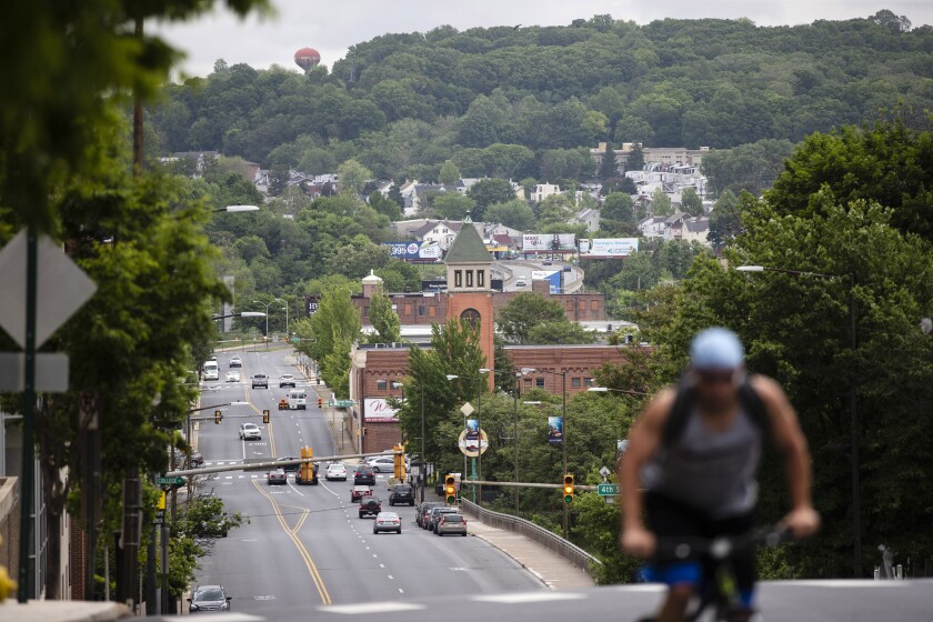 A cyclist pedals up a hill in Allentown, Pa., Friday, May 29, 2020. Allentown predicts a budget deficit of over $10 million, a number officials say could go higher if the economy doesn't rebound quickly. (AP Photo/Matt Rourke) (AP Photo/Matt Rourke)