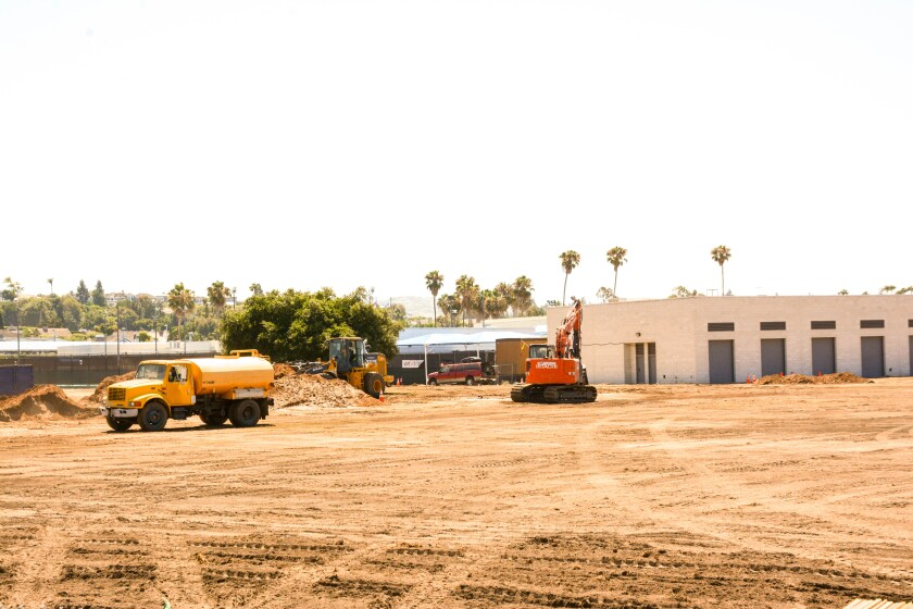 Construction equipment is present for the renovation of two sports fields at Corona del Mar High School.