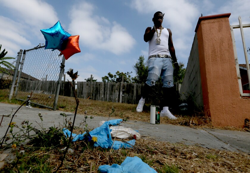 Communiy activist Reggie Cole pays a visit to the site near where Dijon Kizzee was shot by L.A. County Sheriff's deputies.