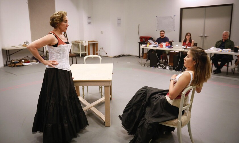 "Joanna Glushak (left) and Regina De Vera rehearse a scene from ""The Underpants."""