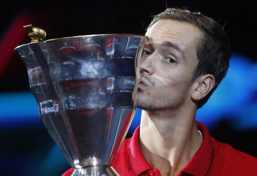 Daniil Medvedev of Russia kisses the trophy after winning the St. Petersburg Open ATP tennis tournament final match against Borna Coric of Croatia in St.Petersburg, Russia, Sunday, Sept. 22, 2019. (AP Photo/Elena Ignatyeva)