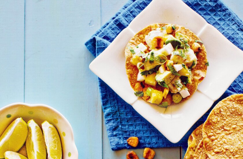 NIM Restaurant's Mixed Ceviche With Coconut is a mixture of fresh seafood, pineapple, avocado and coconut meat.