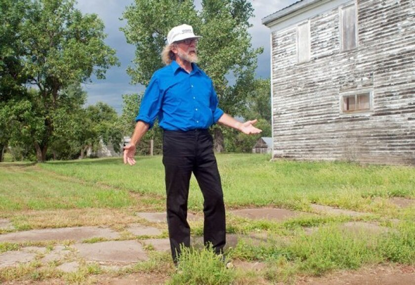 """Craig Cobb stands in an empty lot he owns on Main Street in Leith, N.D. Cobb wrote on a white supremacist message board that """"we could declare a Mexican illegal invaders and Israeli Mossad/IDF spies no-go zone."""""""