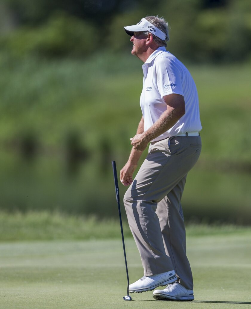 Colin Montgomerie reacts after narrowly missing a putt on an eagle opportunity during the final round of the Senior PGA Championship golf tournament at Harbor Shores Golf Club in Benton Harbor, Mich., Sunday, May 29, 2016. Colin Montgomerie finished second with a score of 16 under. (AP Photo/Robert