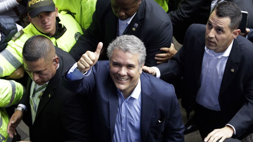 Ivan Duque, presidential candidate for the Democratic Center, gives a thumbs up after voting during the presidential election in Bogota, Colombia, on May 27, 2018.