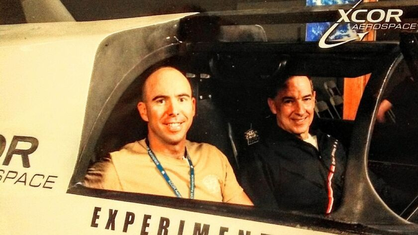 Steve Jones, left, was one of the hopefuls to ride XCOR's Lynx suborbital space plane. He and other