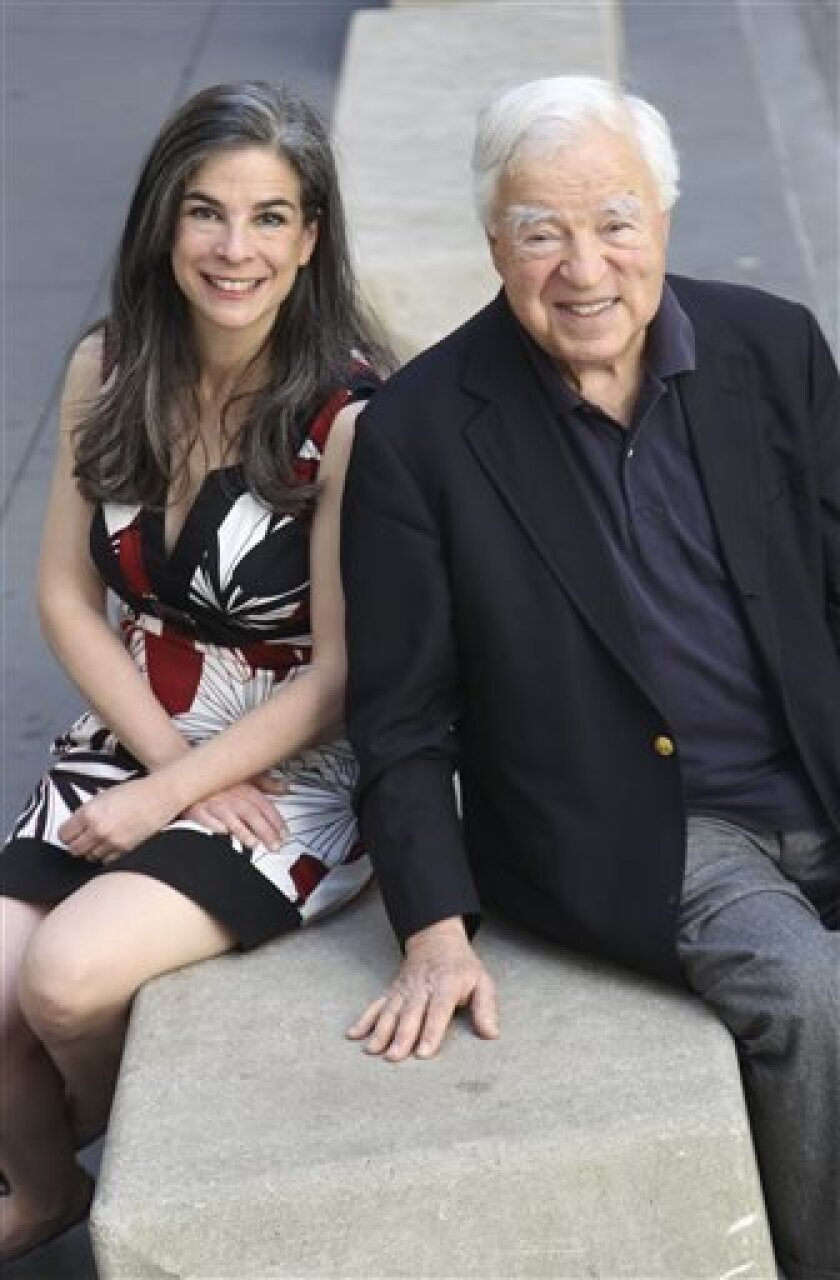 FILE - This May 20, 2012 file photo shows Arthur Frommer and his daughter, Pauline Frommer, in New York. Arthur Frommer said Wednesday, April 3, 2013 that he has reacquired rights to his travel guidebook brand from Google, and that he intends to resume publishing Frommer guidebooks. (AP Photo/Seth Wenig, File)