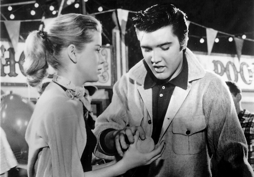 """Delores Hart and Elvis Presley in """"Loving You"""" (1957)."""