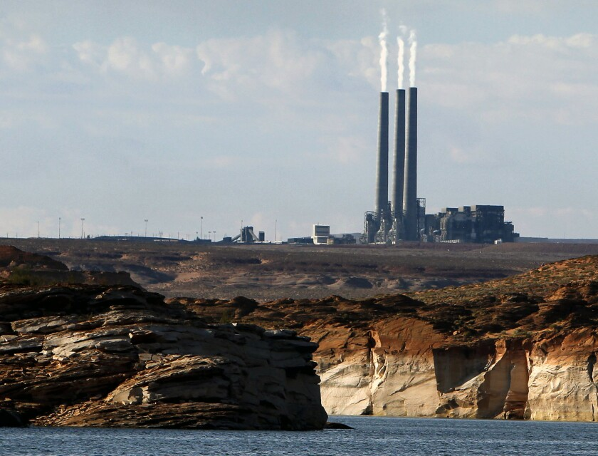 The Navajo Generating Station coal power plant, as seen from Lake Powell in Page, Ariz.