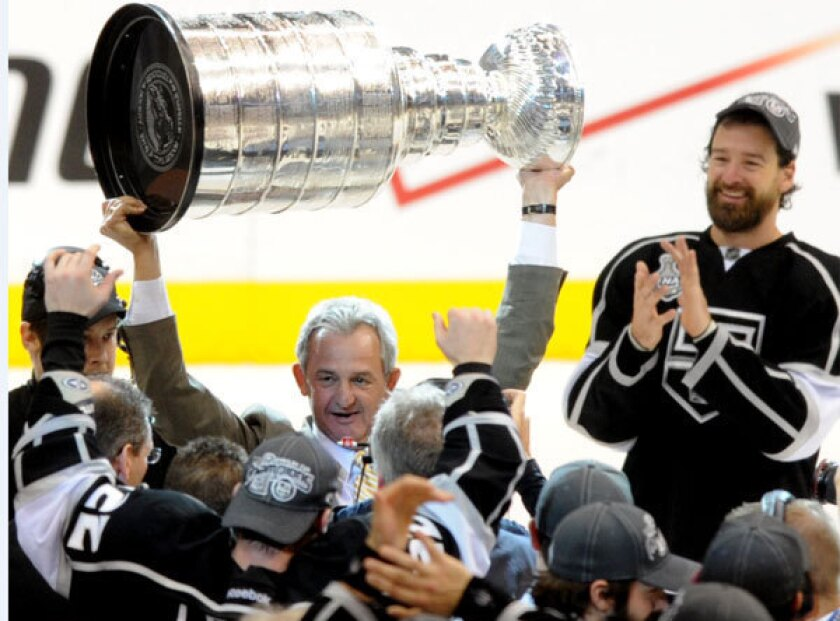 Kings coach Darryl Sutter celebrates with the Stanley Cup following the team's victory over the New Jersey Devils in 2012.