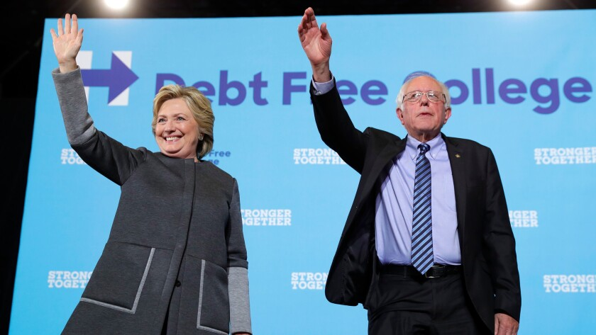 Democratic presidential candidate Hillary Clinton and Sen. Bernie Sanders (I-Vt.) acknowledge the audience at a campaign stop at the University Of New Hampshire in Durham, N.H., on Sept. 28.