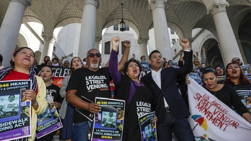 Sidewalk vendors, members of the Los Angeles Vendor Campaign and their backers rally at L.A. City Hall in support of the Safe Sidewalk Vending Act.